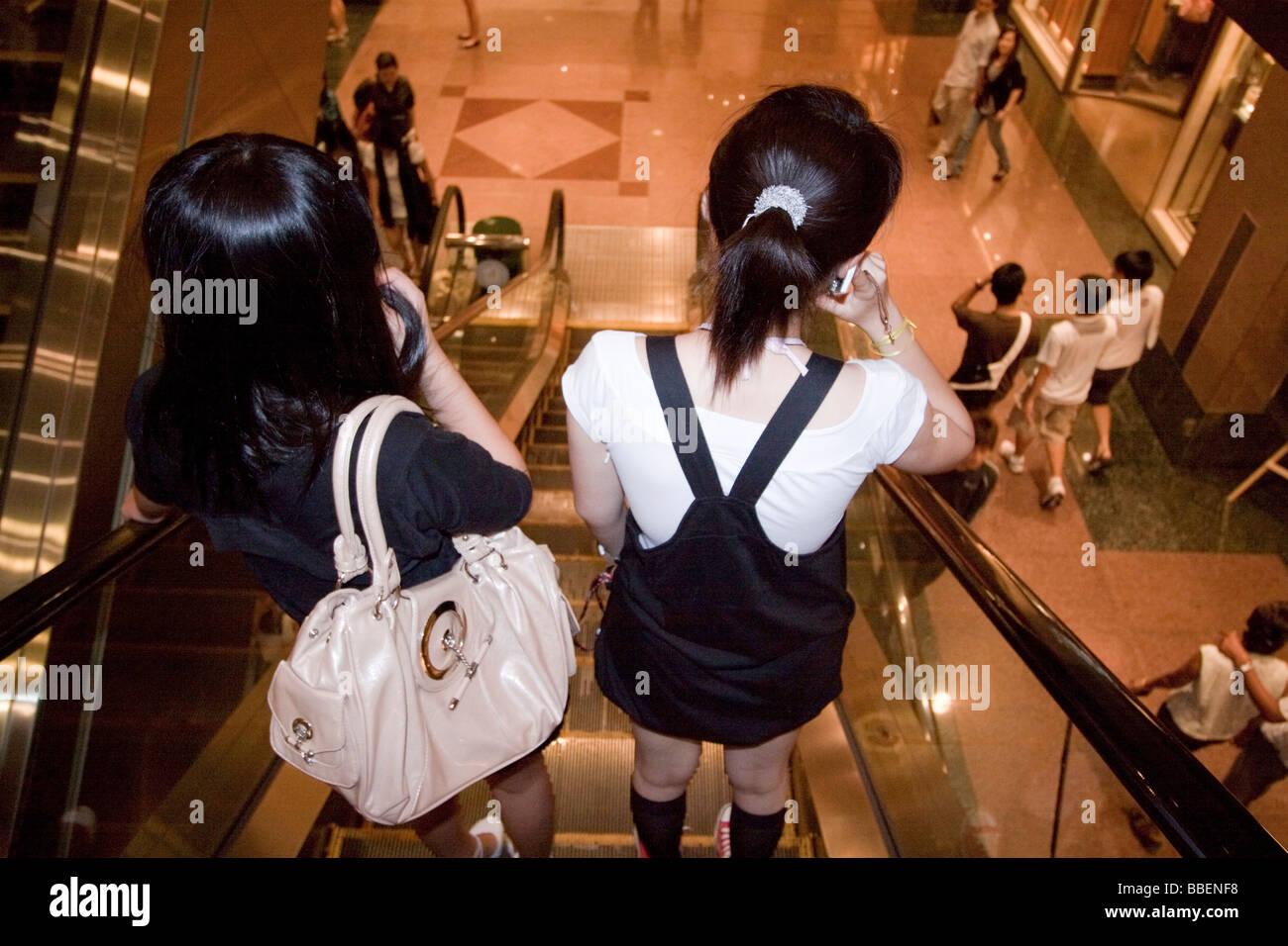 girls on shopping trip in Ngee Ann City Takashimaya shopping center Orchard road shopping zone Singapore Asia Singapur - Stock Image