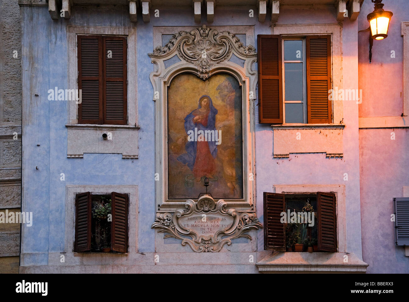 religious image on the facade of a palace in Rome in Italy - Stock Image