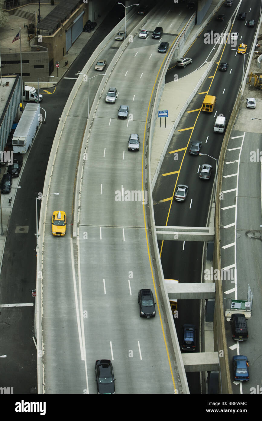 Elevated freeway, busy city streets - Stock Image