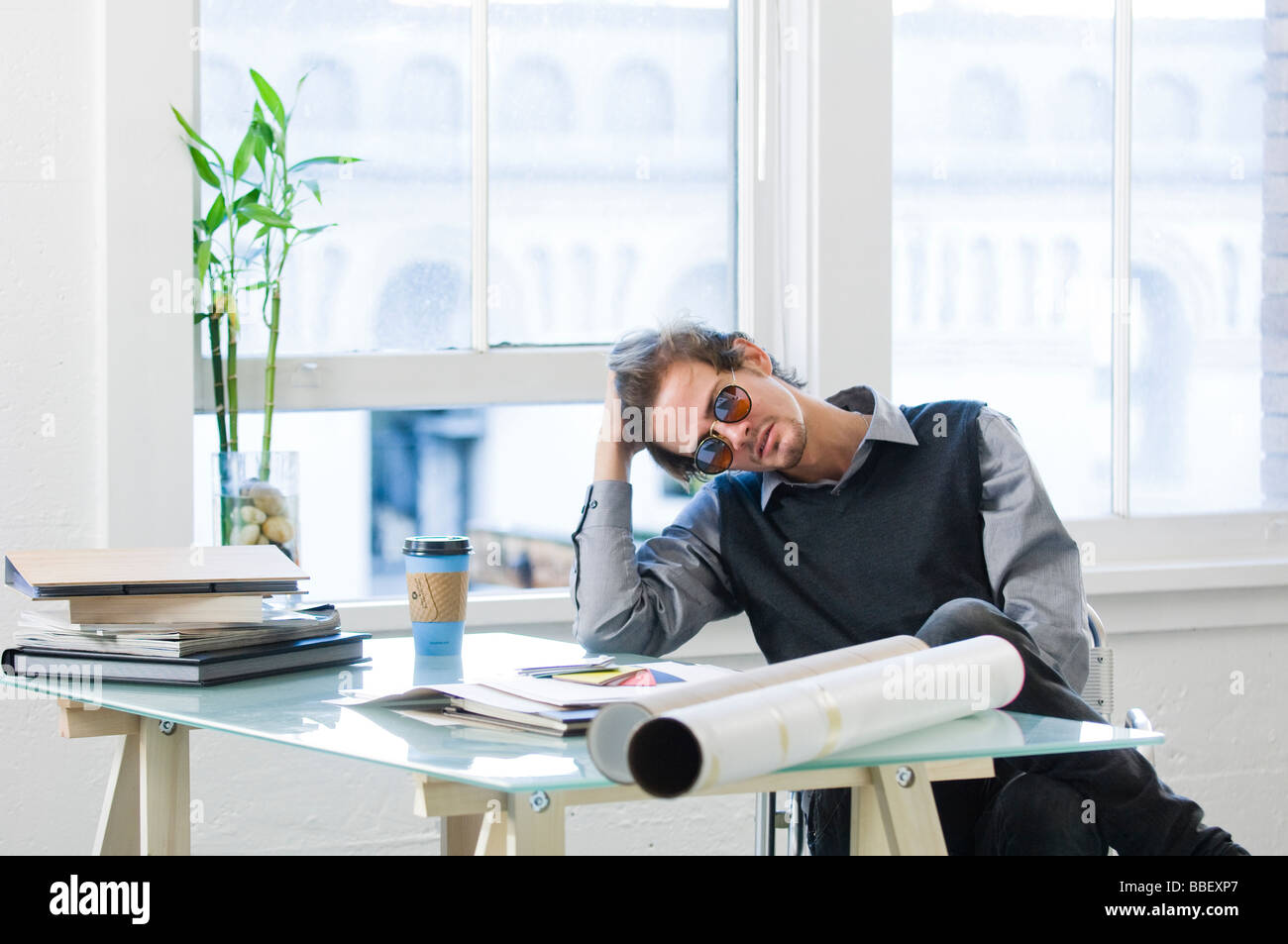Young businessman at a desk - Stock Image