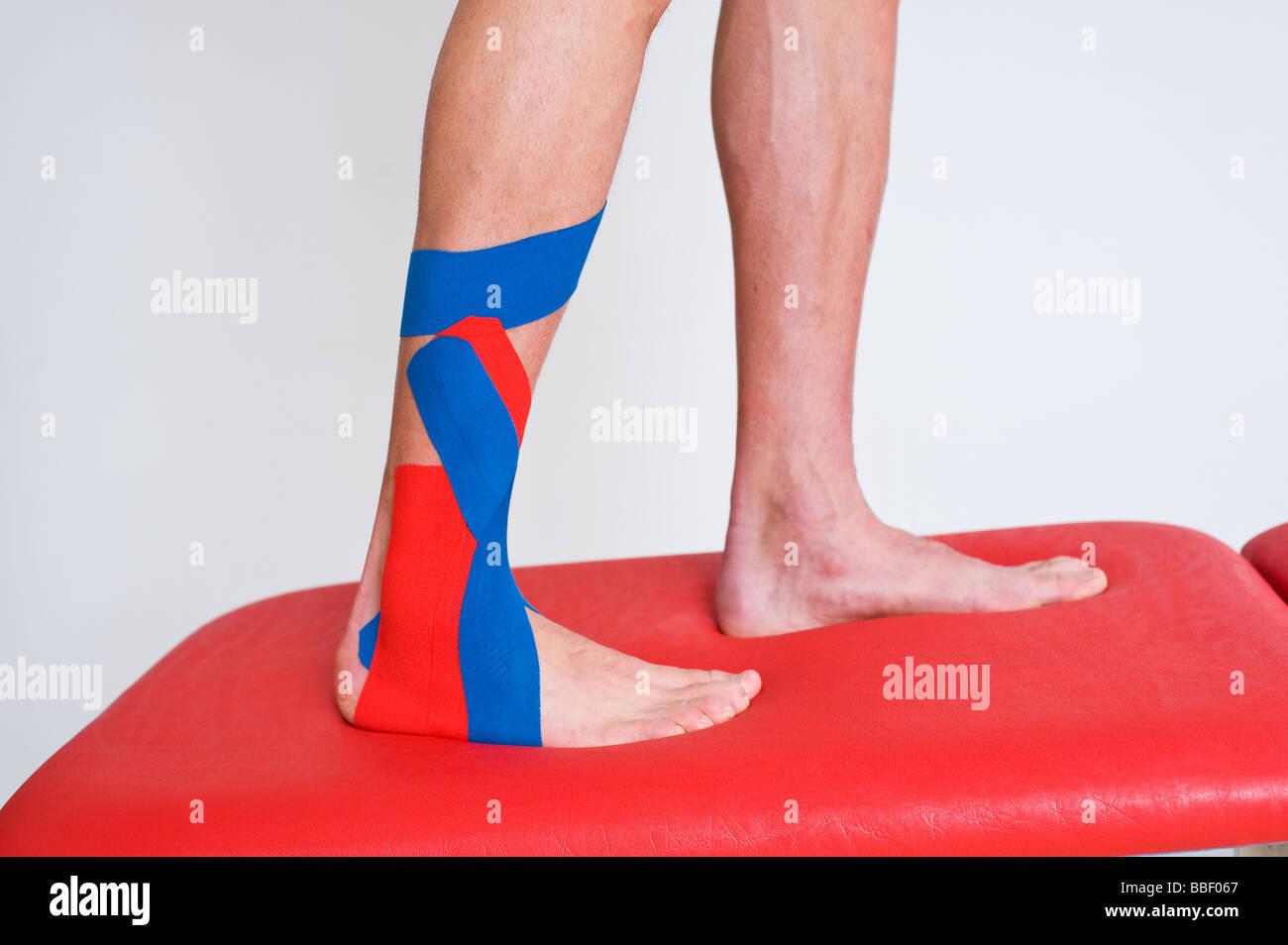kinesiotape, stabilisation ankle, supination trauma Stock Photo ...