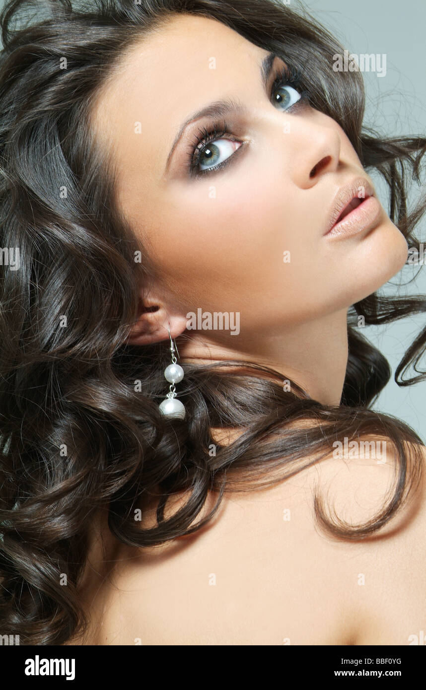 A beautiful dark hair woman with clear skin and beautiful green eyes - Stock Image