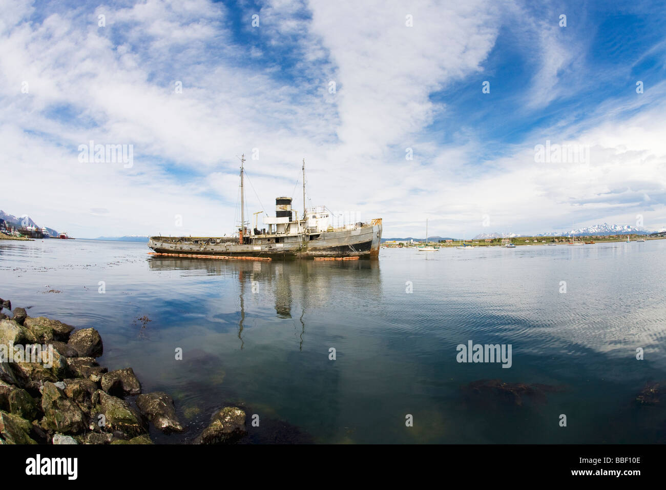 Beached tugboat St Christopher in Ushuaia harbour in early morning light Tierra del Fuego Argentina South America - Stock Image