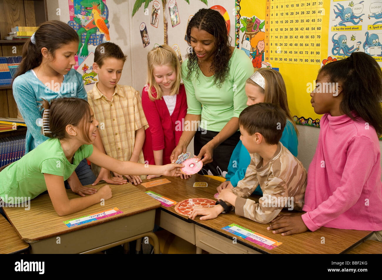 racial diversity racially diverse multicultural multi cultural interracial Teacher teaching concept division children - Stock Image