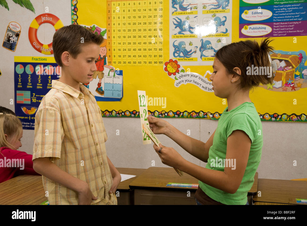 Two young Children 8-9 year years old studying math flash cards wall ...