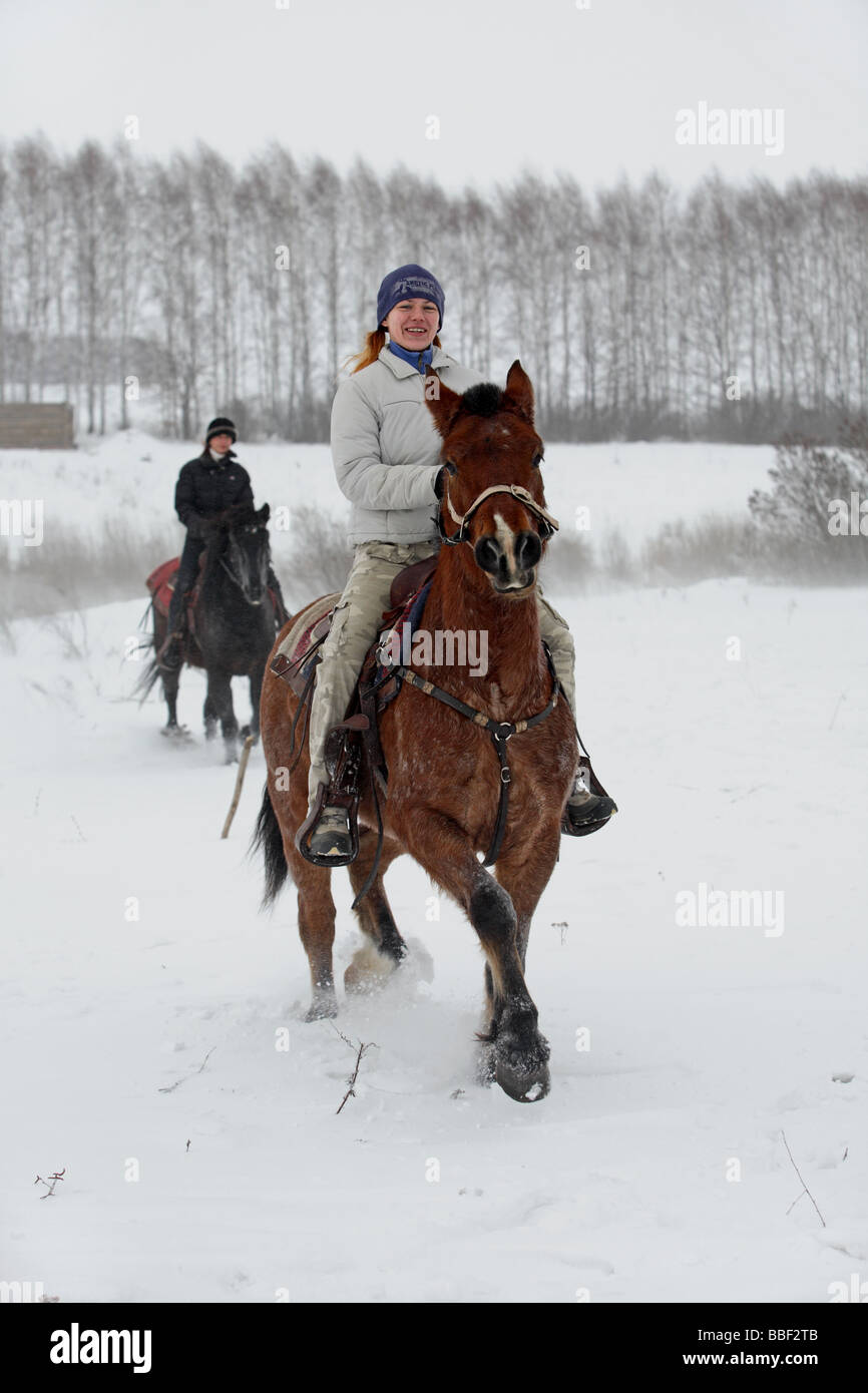 Two young lady riders on Haflinger horse in winter Stock Photo ...