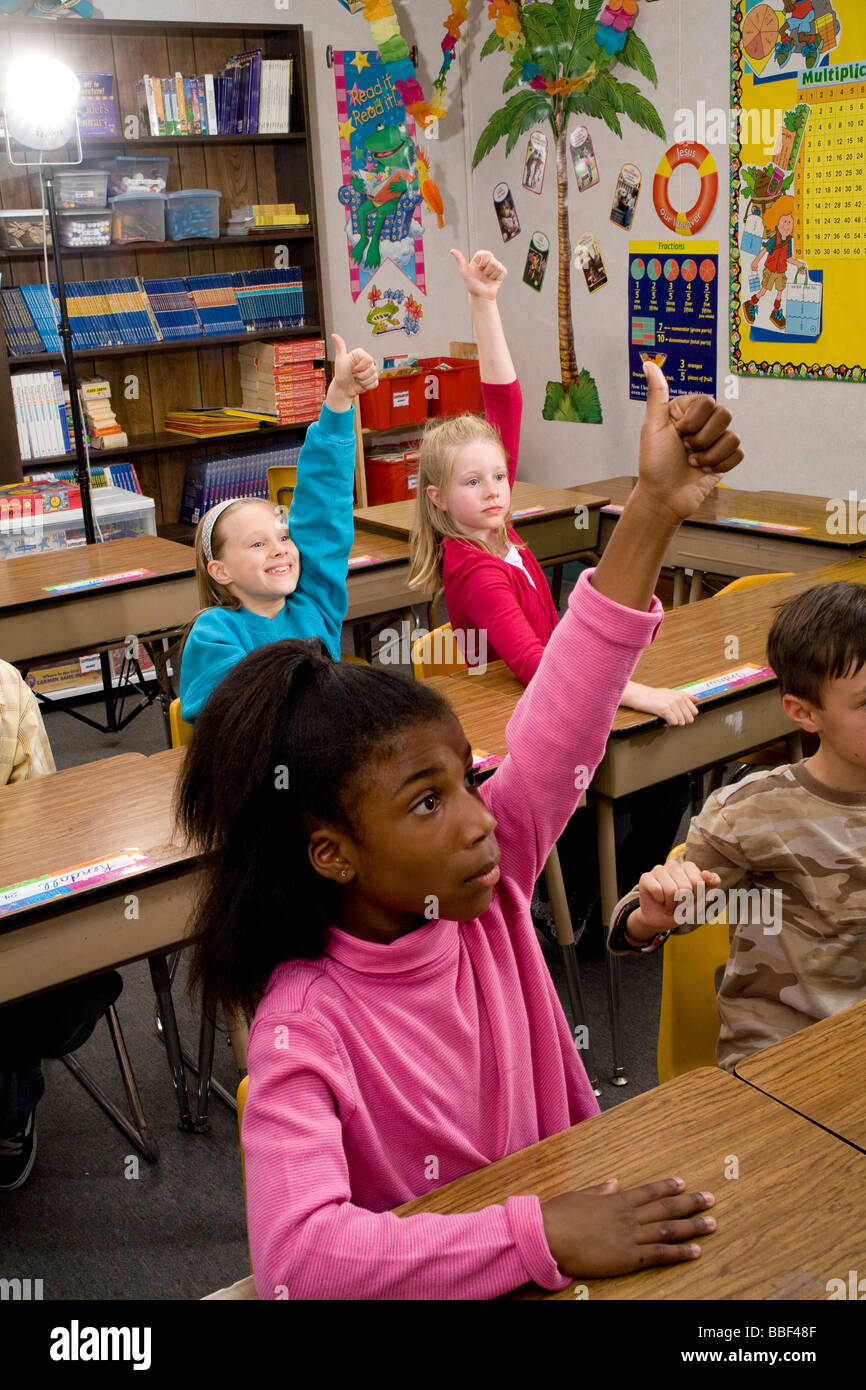 inter racial diversity racially diverse multicultural multi cultural interracial 3rd grade student 8-10 year old - Stock Image