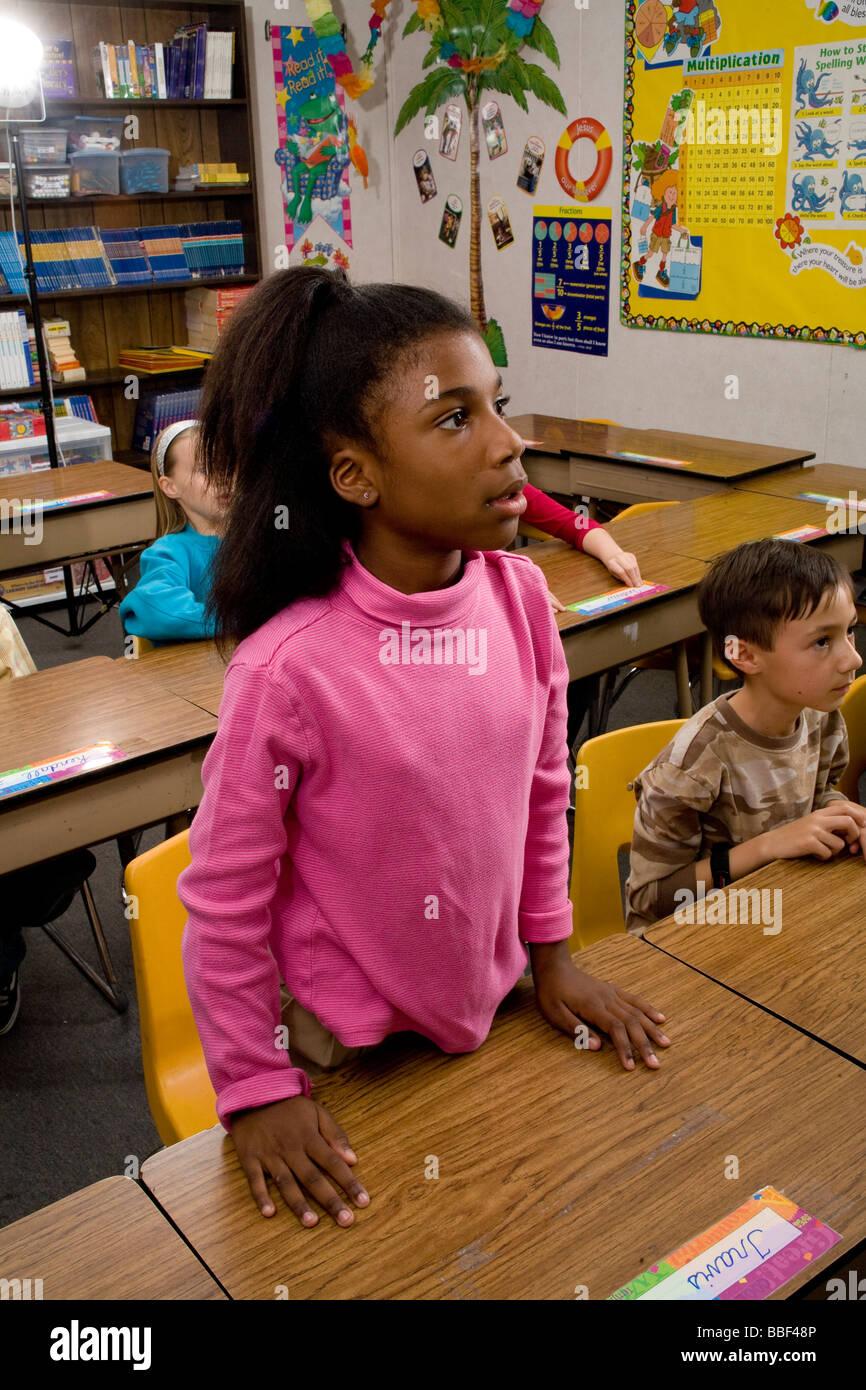 inter racial diversity racially diverse multicultural multi cultural interracial African American Girl 8-10 year - Stock Image