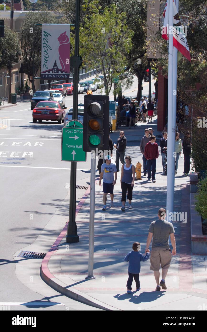 Street scene with people walking on sidewalk on main street in downtown Los Gatos California - Stock Image