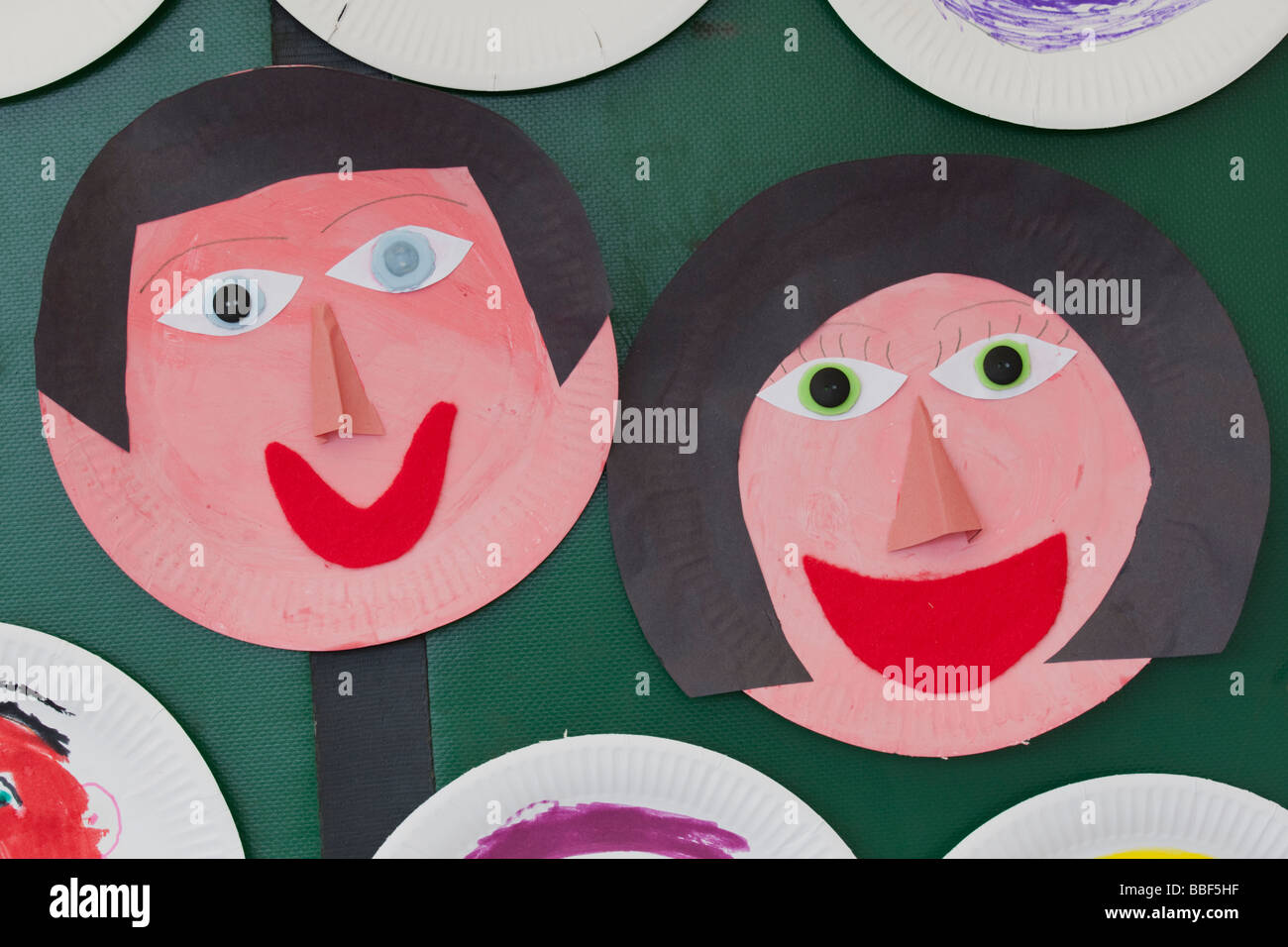funny faces made from painted paper plates May Day Woodmancote Cheltenham UK 2009 & funny faces made from painted paper plates May Day Woodmancote Stock ...
