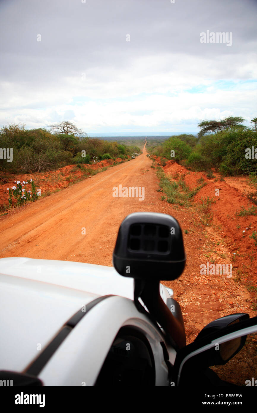 straight road reaching across the Manyara region in Tanzania - Stock Image