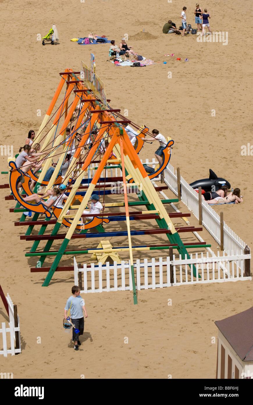 Broadstairs, Kent, England, UK. Viking Bay beach swings - Stock Image