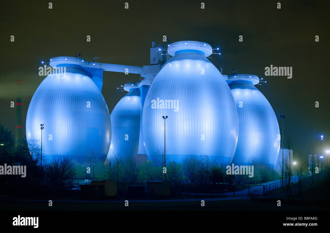 digestion towers of the clarification plant in Bottrop Ruhr Area floodlited at night Faultürme des Bottroper - Stock Image