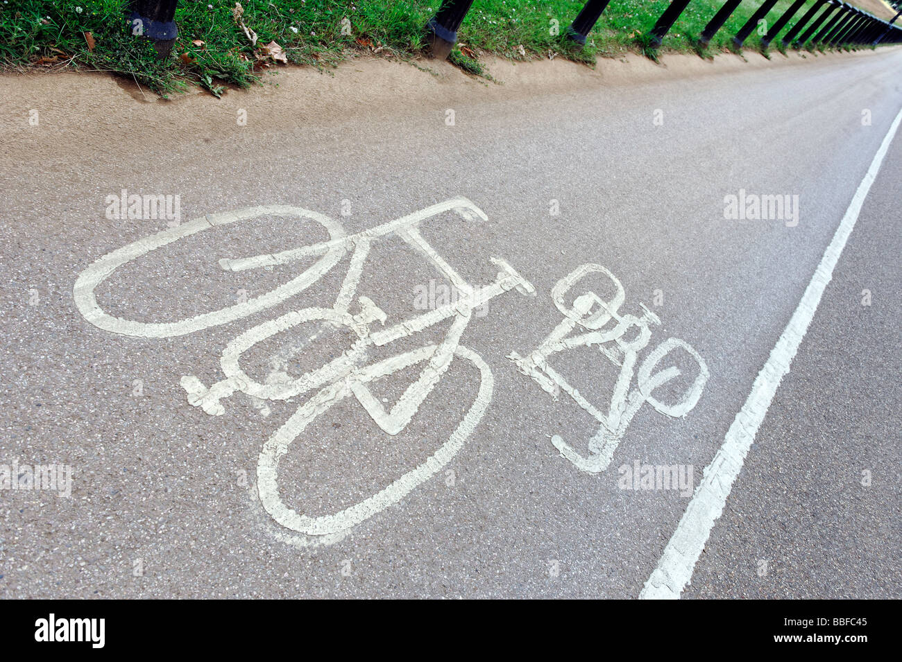 Painted sign on road indicating a cycle way - Stock Image