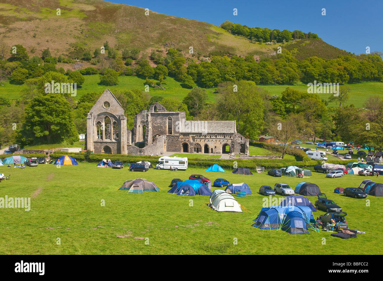 Campsite with tents Valle Crucis 13th century Cistercian Abbey Ruins near Llangollen North Wales Cymru UK United - Stock Image