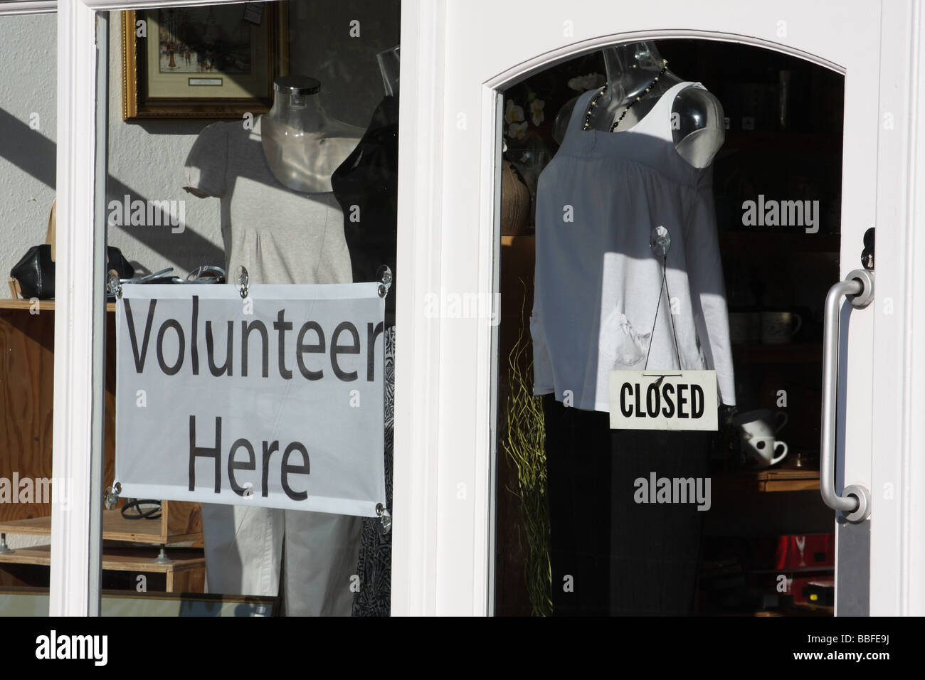 A charity shop in a U.K. city. - Stock Image
