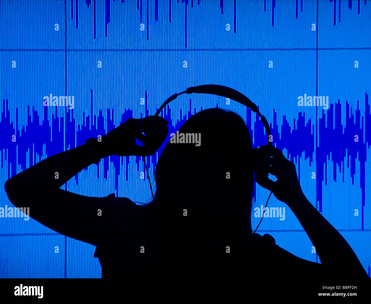 female disk jockey with headset and audio projection - Stock Image