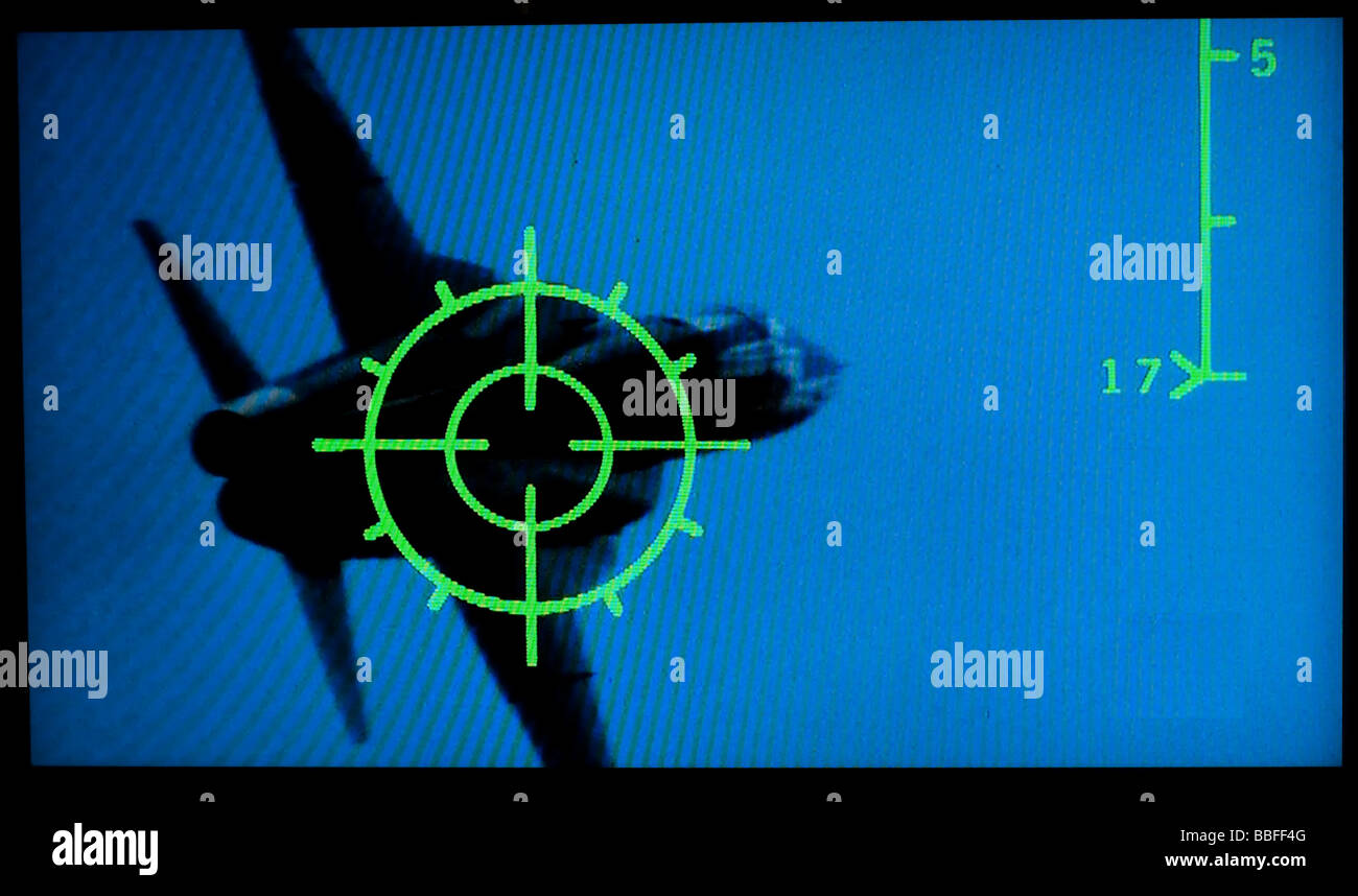frame from movie Topgun showing a fighter jet in crosshairs of another fighter - Stock Image
