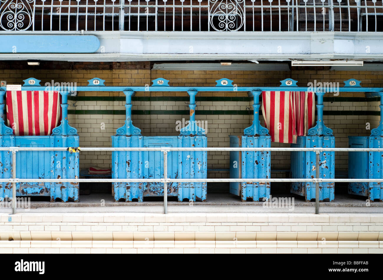Changing cubicles in the first class male pool at Victoria Baths in Manchester, England, UK, prior to the building's - Stock Image