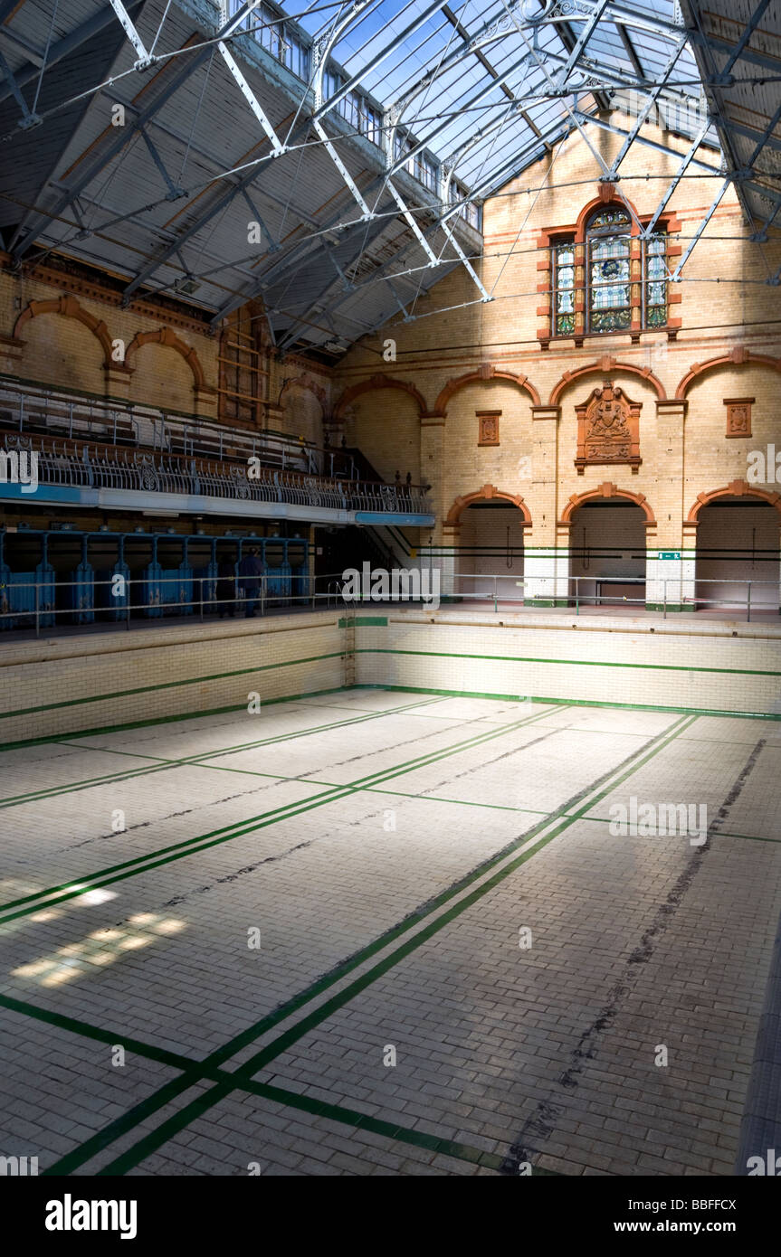 The interior of Victoria Baths in Manchester, England, UK, before completion of the building's restoration - Stock Image