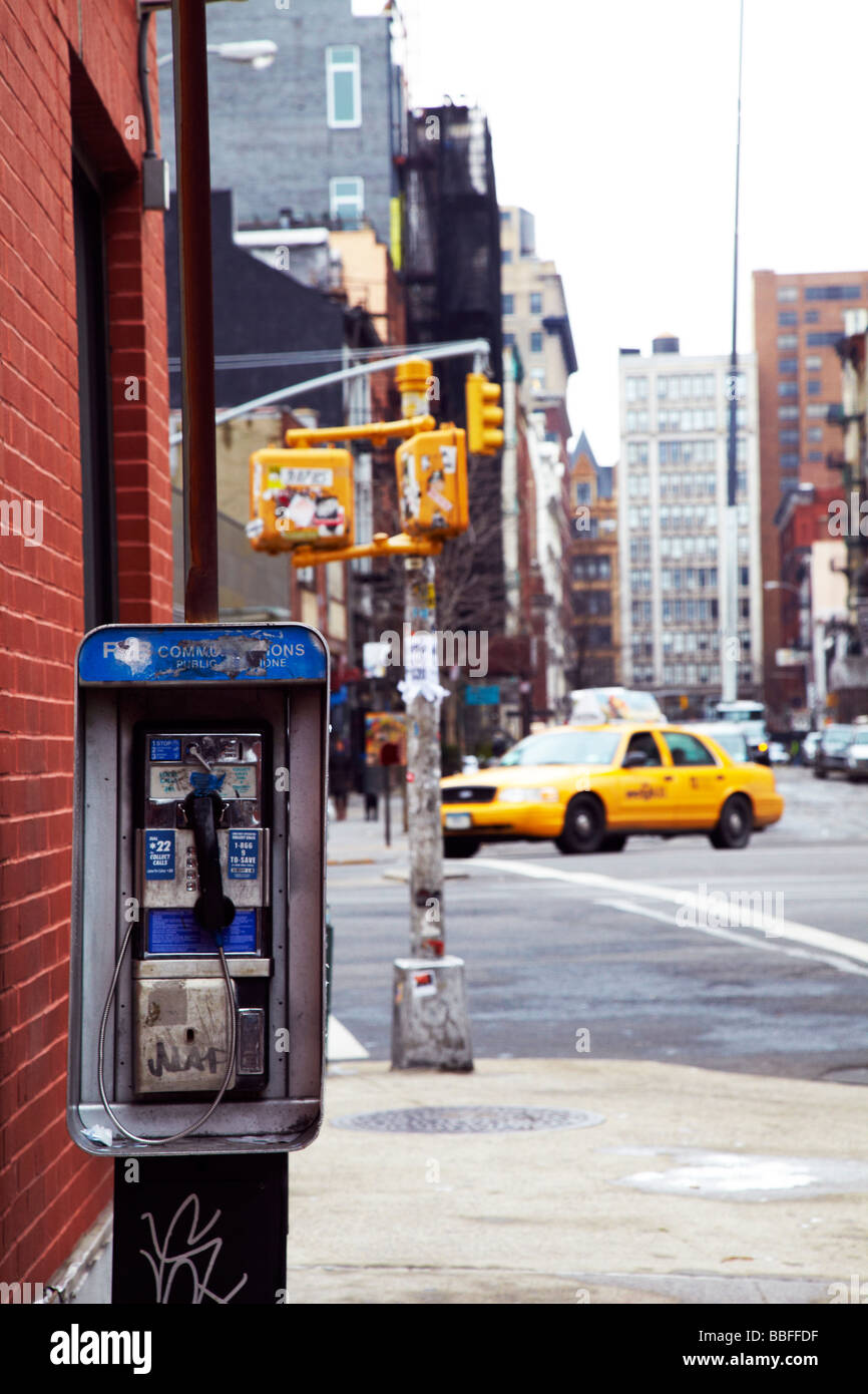 payphone and taxi, New York - Stock Image