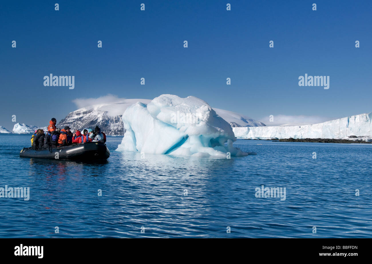 Tourists on board an inflatable boat enjoying the scenery around Brown Bluff in Antarctica - Stock Image