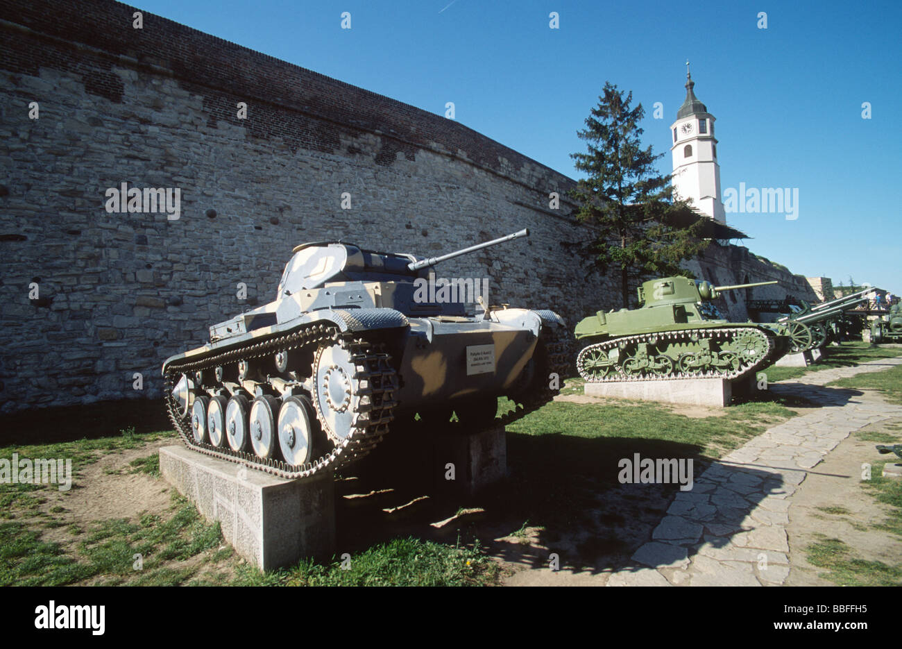 Second world war tanks and flags exposed in the military museum in the citadel walls of Kalemegdan park, Belgrade, - Stock Image