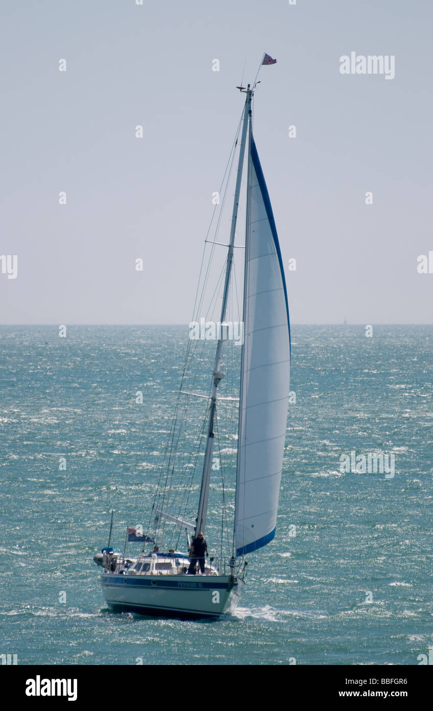 A sailing yacht with its jib raised Stock Photo