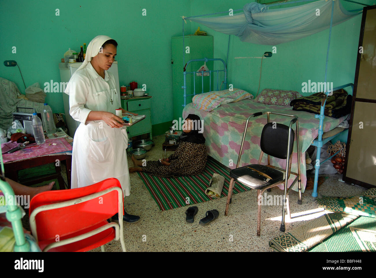 Sister Laura is making her morning check up on all female leprosy patients in Egypt's leprosy colony. - Stock Image