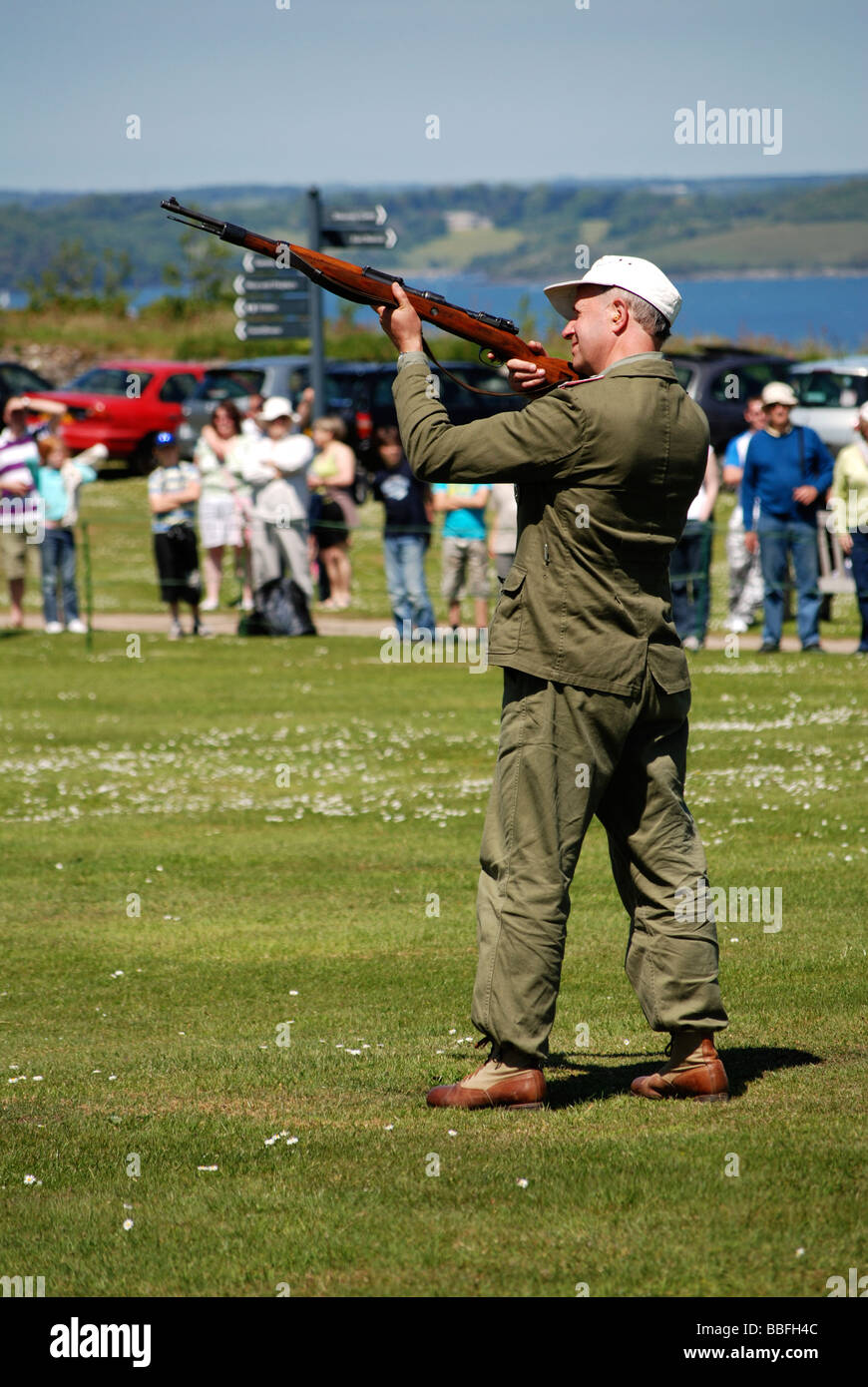 a second world war german soldier shooting a rifle at d.day remembrance day at falmouth,cornwall,uk - Stock Image