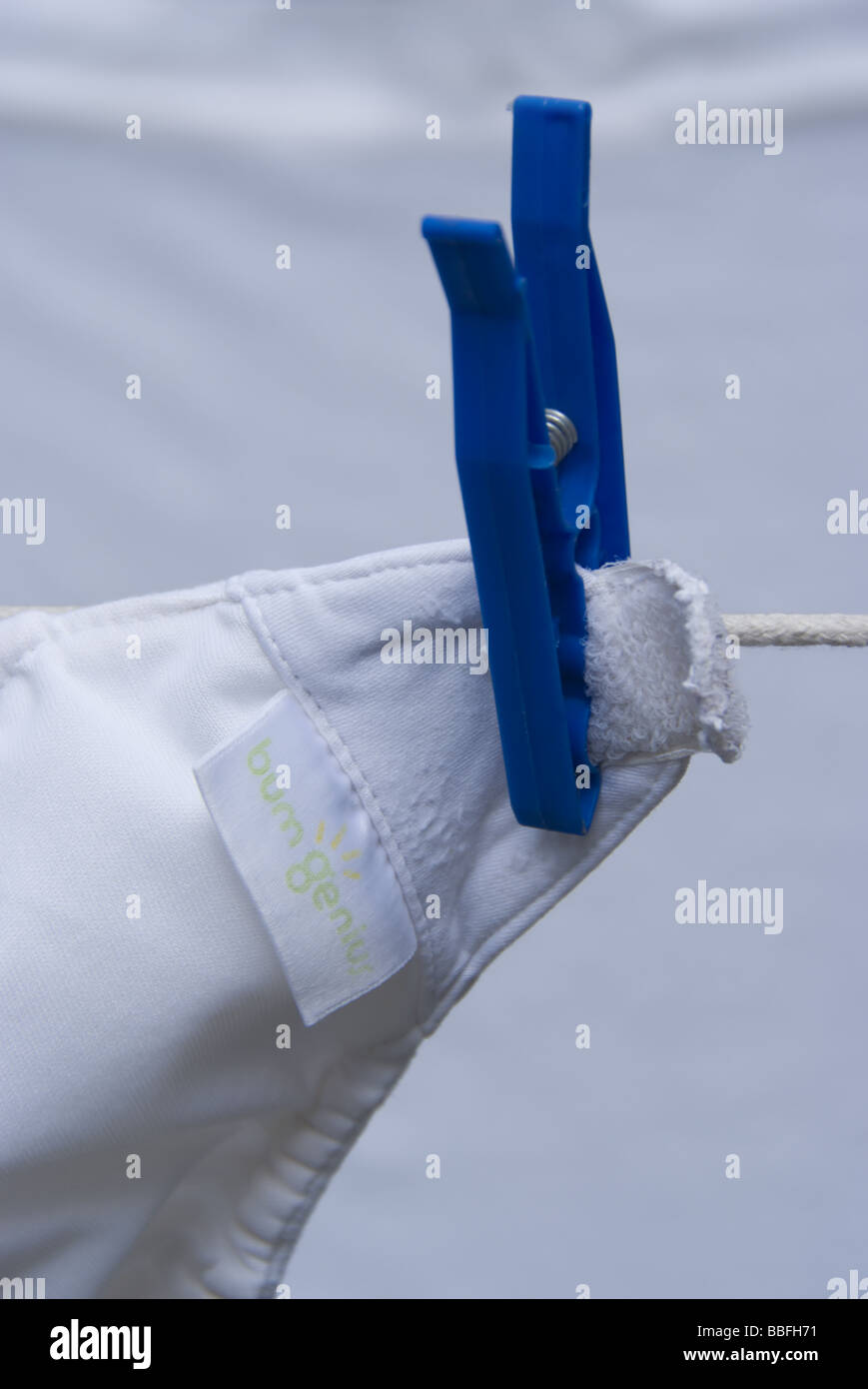 A real nappy drying on a washing line - Stock Image