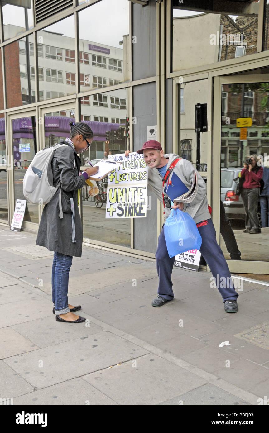 Signing a petition outside the London Metropolitan University Holloway London UK - Stock Image