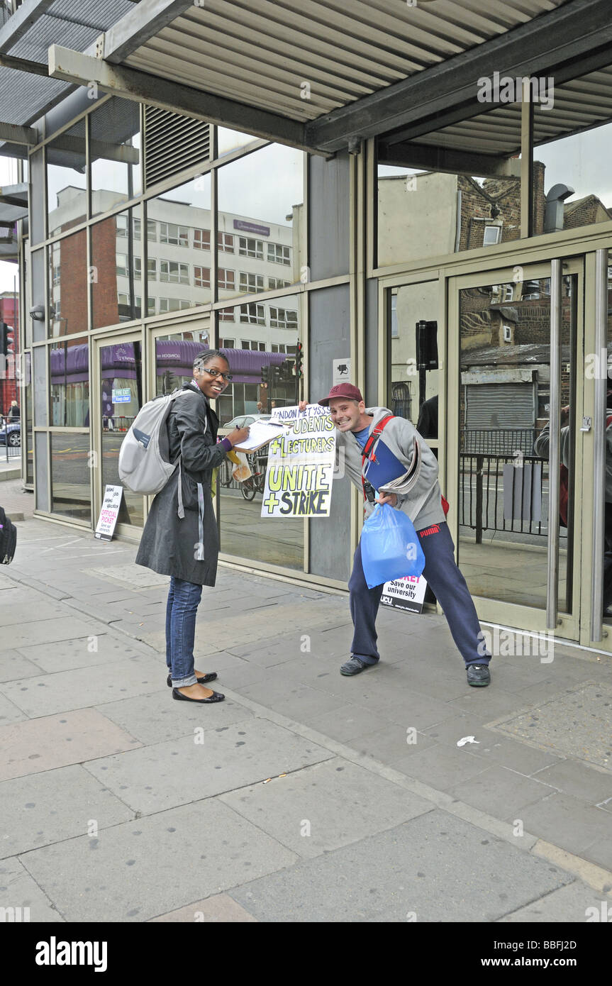 Signing a petition against cut outside the London Metropolitan University Holloway London UK - Stock Image