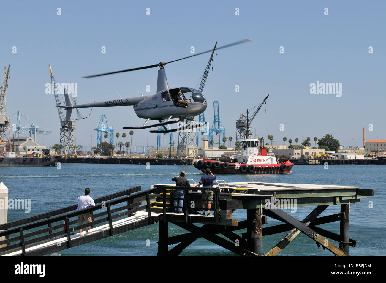 Small helicopter type Robinson R22, a two-bladed, single-engine light utility helicopter manufactured by Robinson - Stock Image