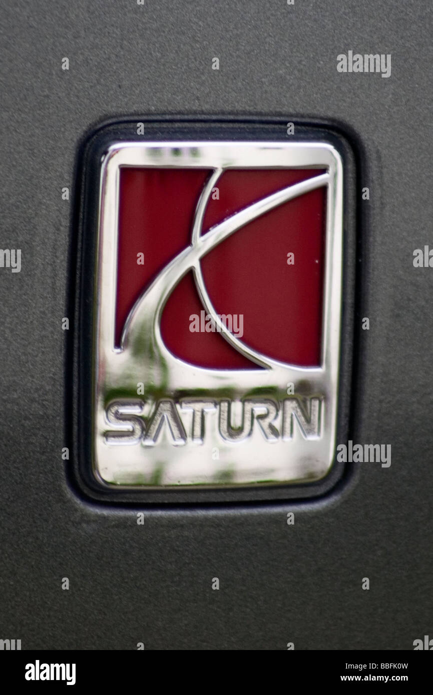 The Saturn logo on the side of a Saturn Vue - Stock Image