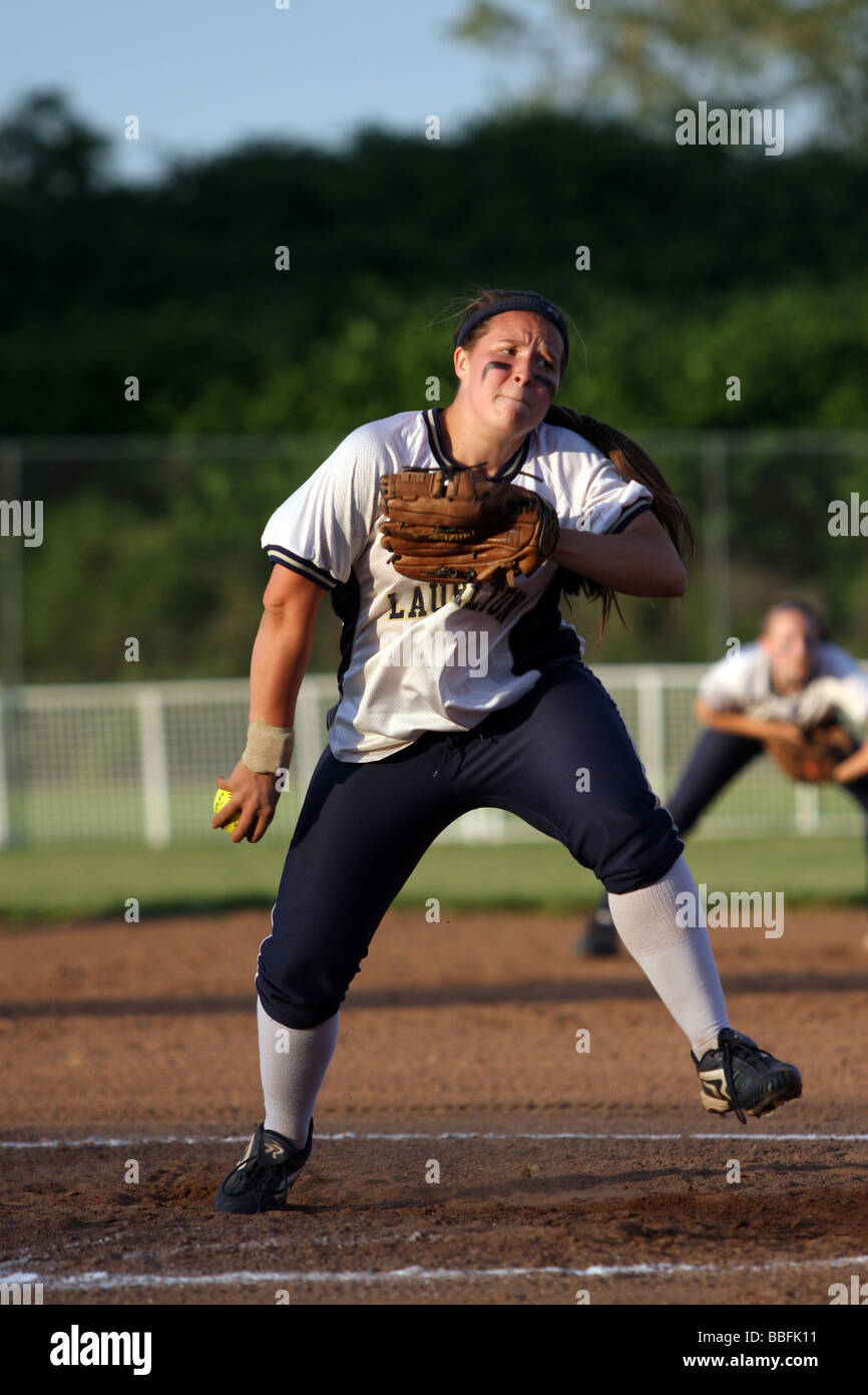 A High School pitcher winds up during a softball game in Stratford Connecticut USA - Stock Image