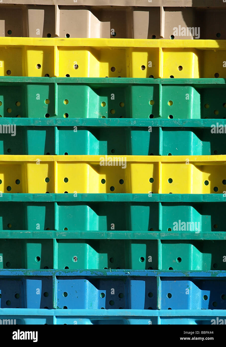 Stock photo of colorful stacked plastic crates in portrait format Stock Photo