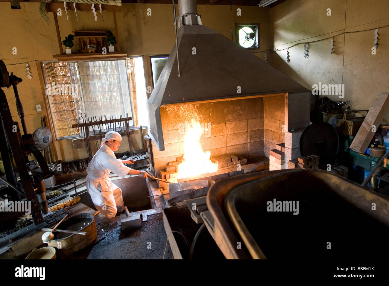 Sadanori Tanaka a swordsmith for 18 years works on a sword in his forge in Komuro Chiba ken Japan - Stock Image