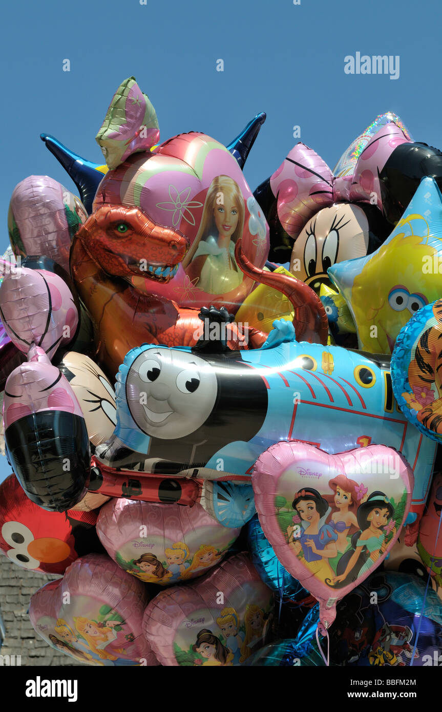 Colorful balloons showing familiar cartoon characters - Stock Image