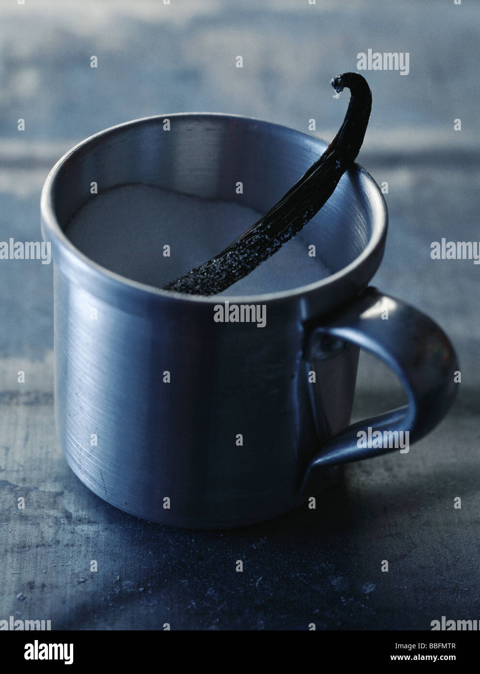 Mug of sugar with vanilla pod - Stock Image