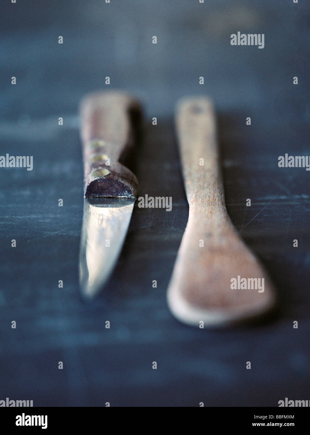 Paring knife with wooden spoon - Stock Image