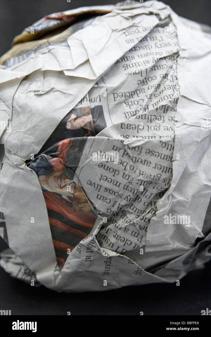 crumpled newspaper ball - Stock Image