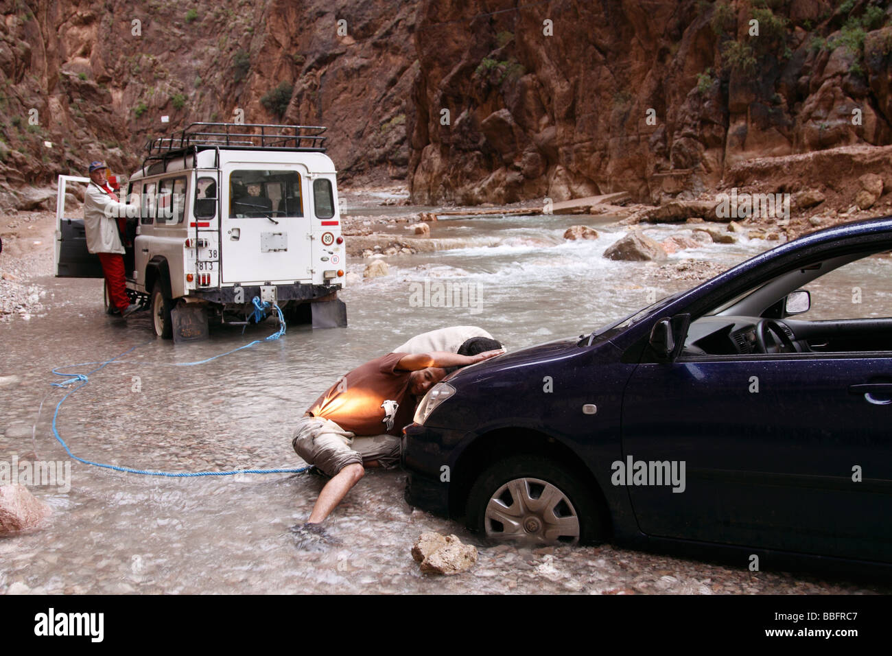 Africa, North Africa, Morocco, Atlas Region, Todra Gorge, Automobile, Vehicle Stuck in Creek - Stock Image