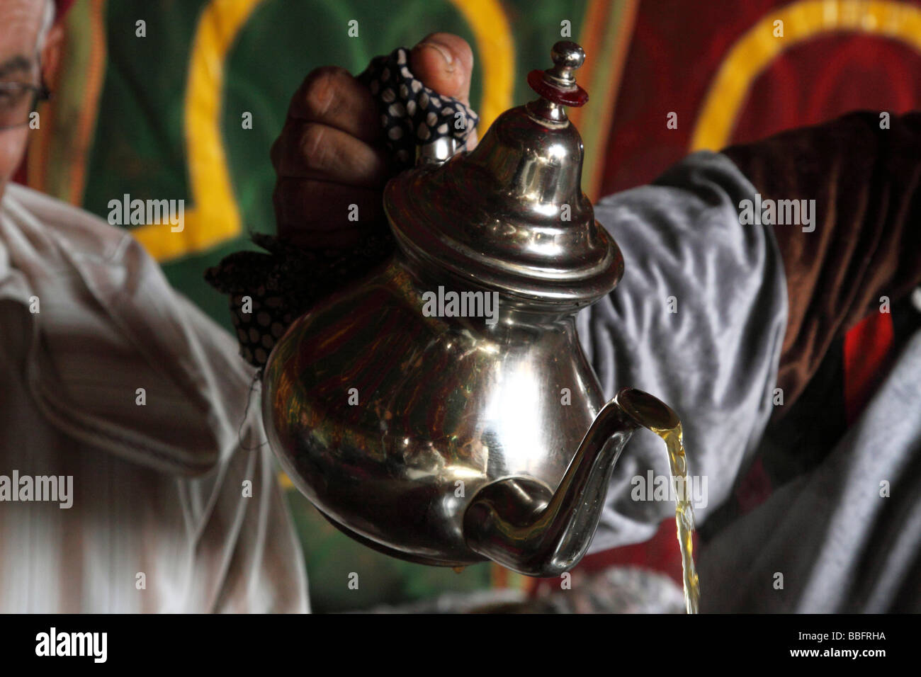 Africa, North Africa, Morocco, Meknes, Hand Pouring Tea - Stock Image