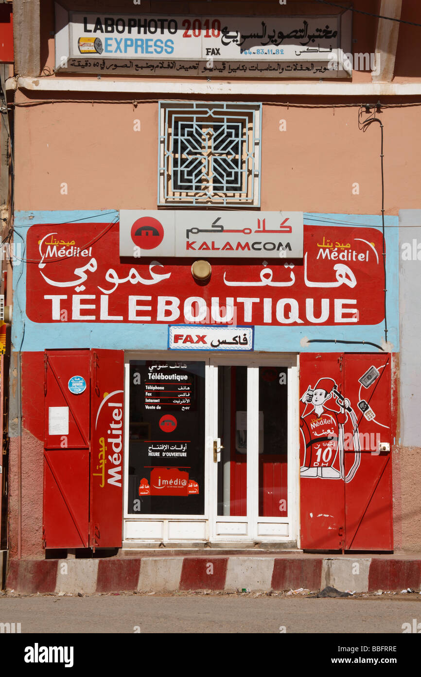 Africa, North Africa, Morocco, Atlas Mountains, Boulemane Town, Public Telephone, Shop Front - Stock Image