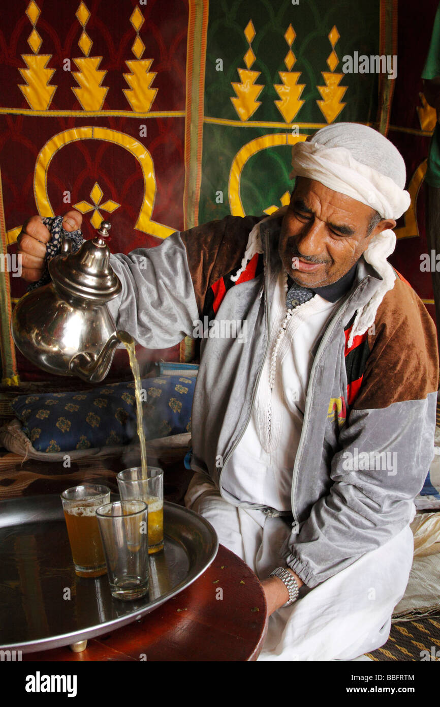 Africa, North Africa, Morocco, Meknes, Decorated Berber Tent, Man Pouring Tea - Stock Image