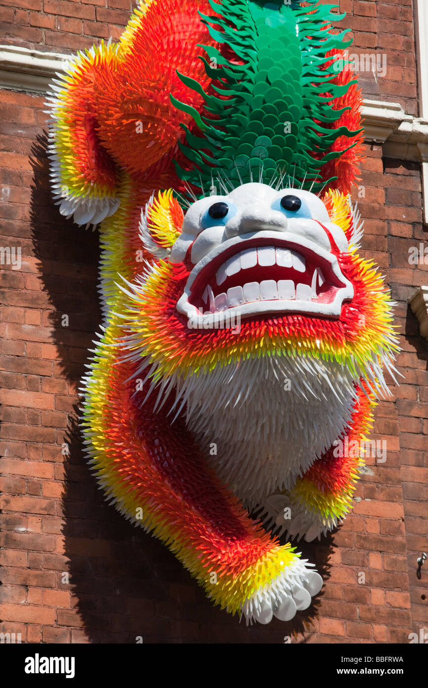 Chinese Figure at the entrance to London's Chinatown in Wardour Street - Stock Image