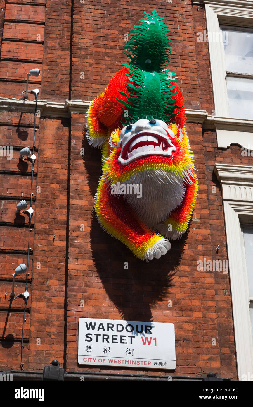 Colourful plastic figure at the entrance to London's Chinatown in Wardour Street - Stock Image