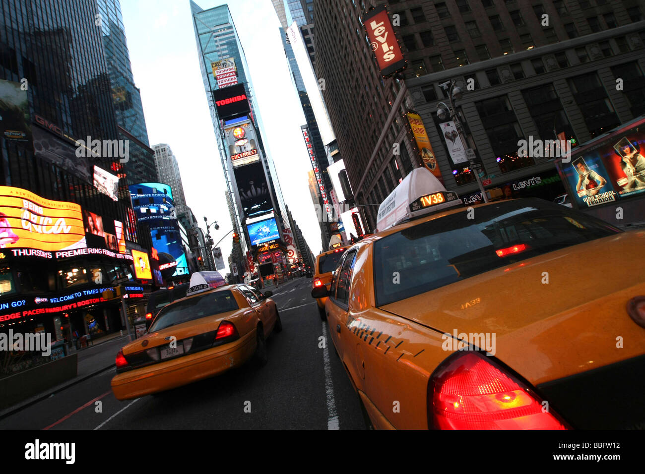 Taxis on Times Square, Manhattan, New York City, NYC, USA, United States of America - Stock Image
