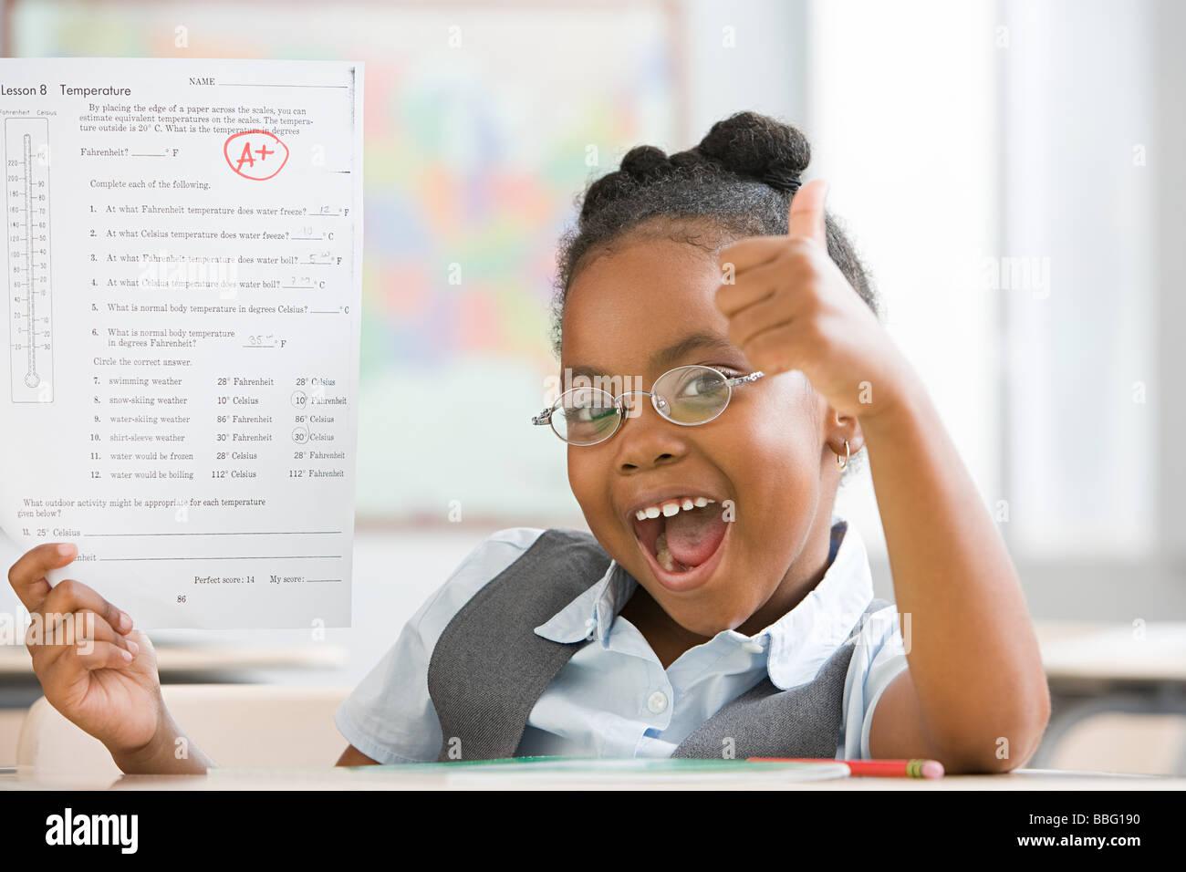 Schoolgirl with top grade - Stock Image